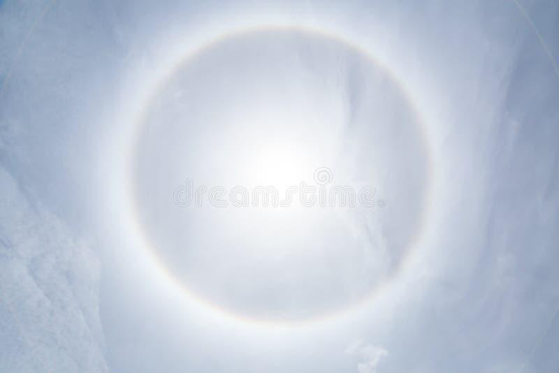 Sun halo phenomenon. Sun halo effect, sun ring in clear blue sky royalty free stock photos