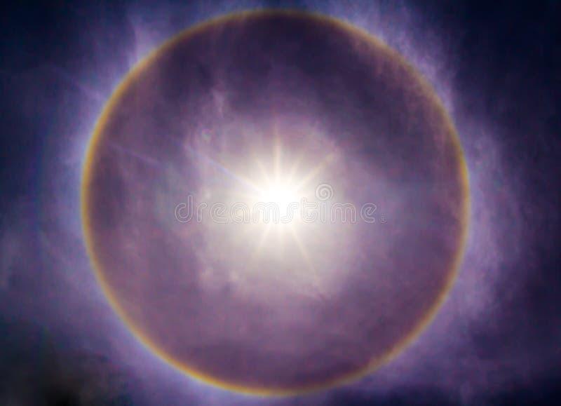 Sun halo phenomenon. Fantastic beautiful sun halo phenomenon royalty free stock photo