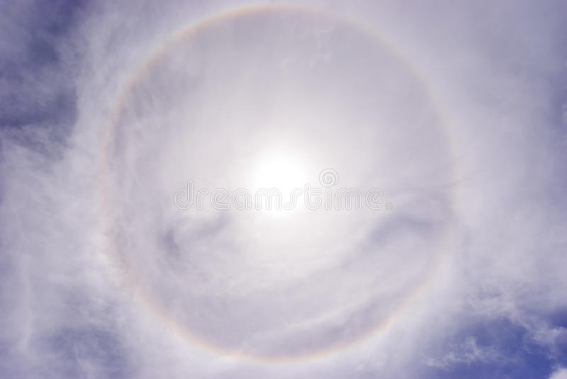Sun halo phenomenon. The halo is an optical effect caused by ice crystals interacting with light stock photography