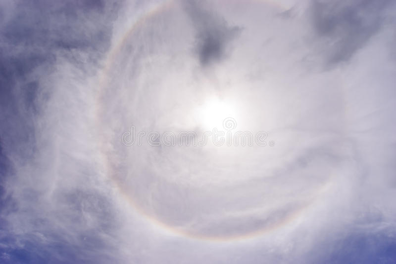 Sun halo phenomenon. The halo is an optical effect caused by ice crystals interacting with light royalty free stock image