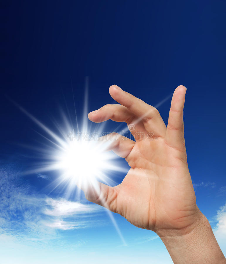 Sun in the hands stock photography