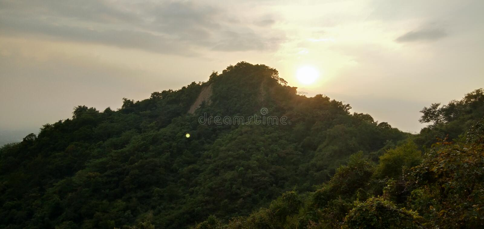 The Sun and the Hill royalty free stock image
