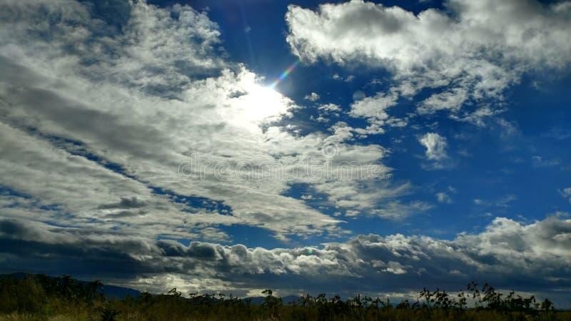 Sun i skyen royaltyfri bild
