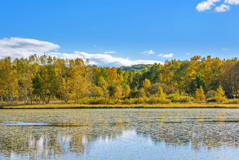 The Sun Lake autumn scenery stock photos