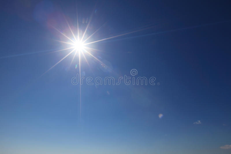 Sun with lens flare stock photography