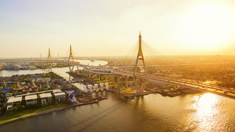 Sun light and bhumiphol bridge crossing chaopraya river in bangkok thailand royalty free stock images