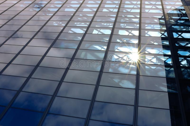 Sun light through blue glass corporate business building architecture background - with copyspace royalty free stock photography