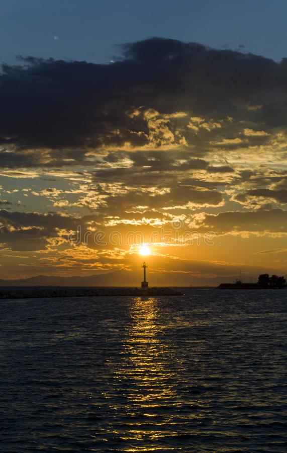 SUN and the LIGHTHOUSE royalty free stock photo