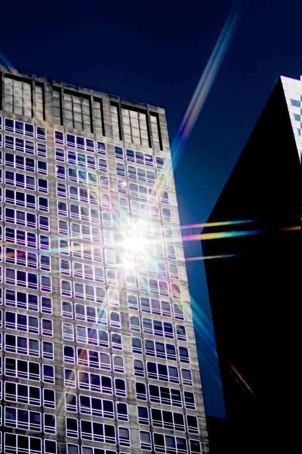 Sun lighting up tall building royalty free stock image