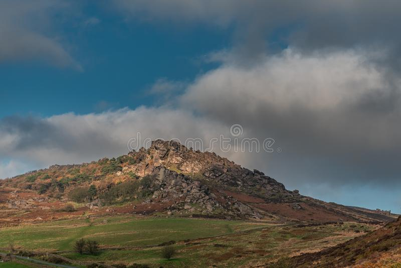 Sun lights the heather and rocks at the Roaches in the Staffordshire Peak District royalty free stock photos