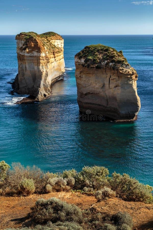 Stacks at the Twelve Apostles, Port Campbell, Great Ocean Road, Victoria, Australia. Sun lit stacks in calm water. Sandstone rocks in deep blue sea royalty free stock photos