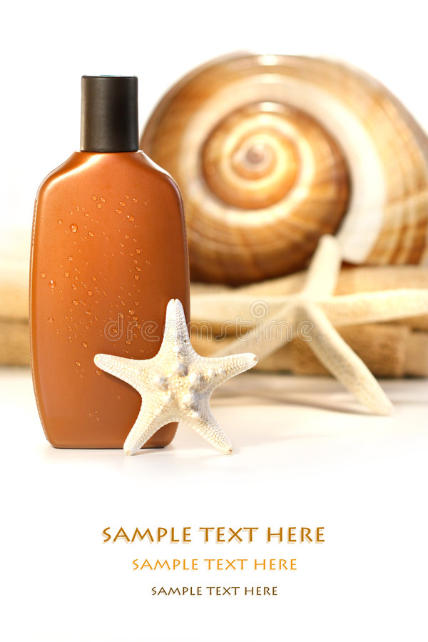 Download Sun Lotion With Seashells And Towel Royalty Free Stock Images - Image: 5449649