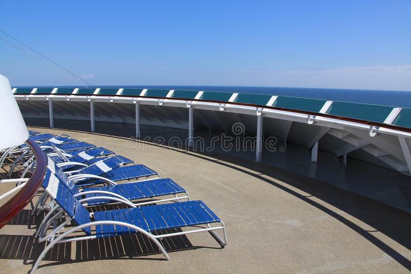 Sun loungers cruise ship deck. Sun loungers on cruise ship deck on sunny day royalty free stock photography