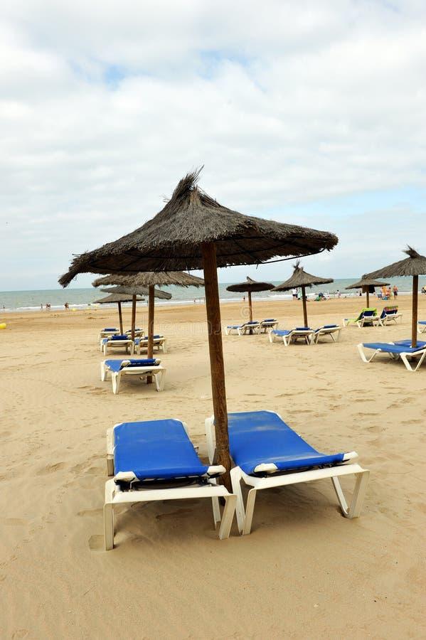Sun loungers and parasols, Victoria Beach, Costa de la Luz, Cadiz, Andalusia, Spain royalty free stock photo
