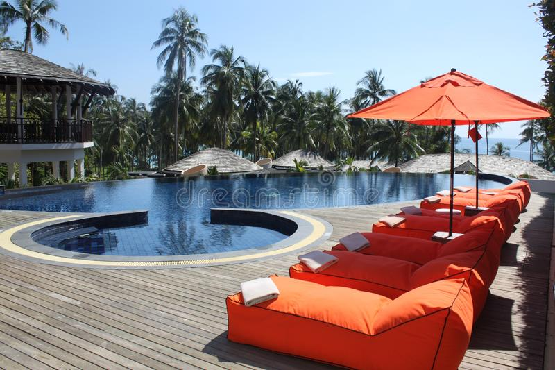 Sun loungers and pool royalty free stock images