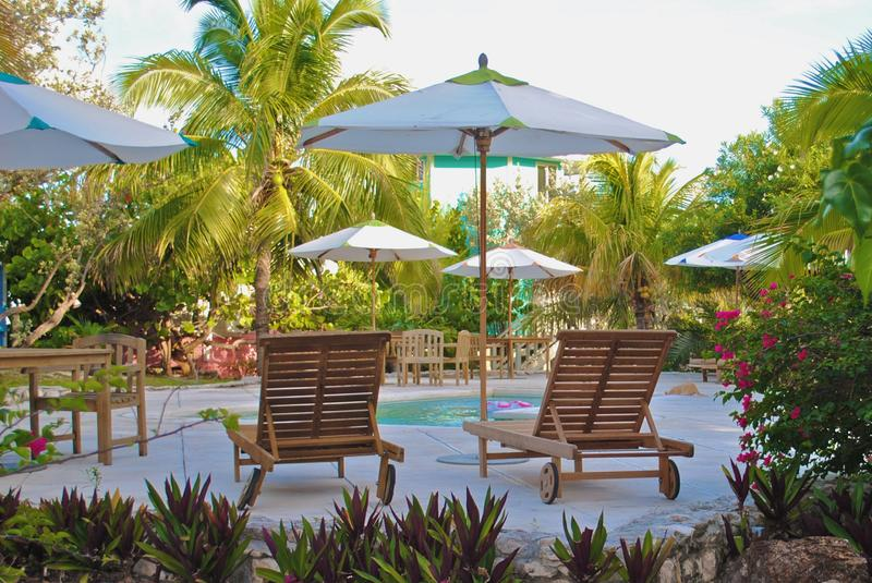 Sun loungers and swimming pool royalty free stock image