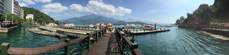 Sun moon Lake, jetty bay tourist picking up royalty free stock photo