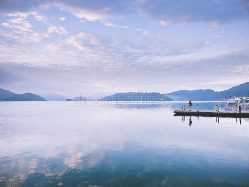Sun Moon Lake sunrise at Pier Scenic Taiwan Landscape. Sun Moon Lake sunrise at Pier Scenic Taiwan Nature Landscape people standing at Pier stock photography