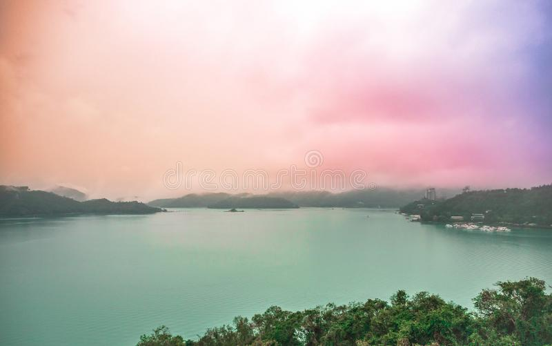 Sun Moon Lake landscape view with pastel rainbow sky in rainy day royalty free stock photography