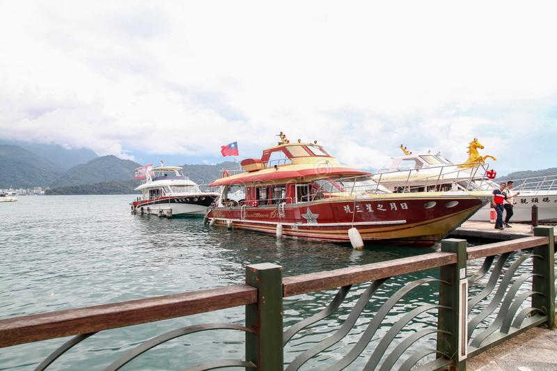 Sun moon lake ,Taiwan-October 13,2018:The ferry speed boat at the Sun Moon Lake harbour .Tourist are used to ferry passengers to 3 stock photos
