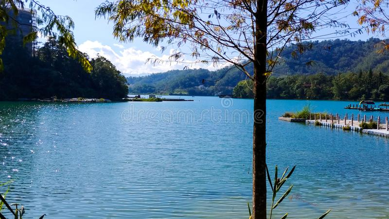 Sun Moon Lake, Taiwan. Picturesque photo of sun moon lake from one angle depicting the beautiful blue water, lush green vegetation on its banks and the mighty stock photos