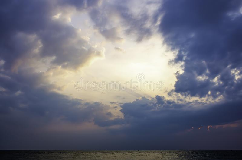 The sun in the morning that reflect the clouds and the sea.  stock photo