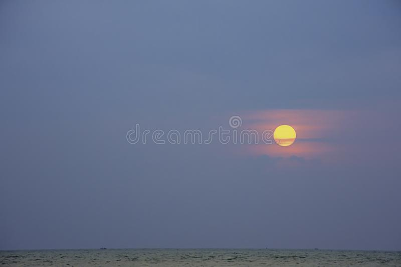 The sun in the morning that reflect the clouds and the sea.  royalty free stock photography