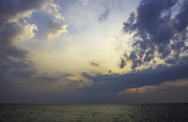 The sun in the morning that reflect the clouds and the sea.  stock photos