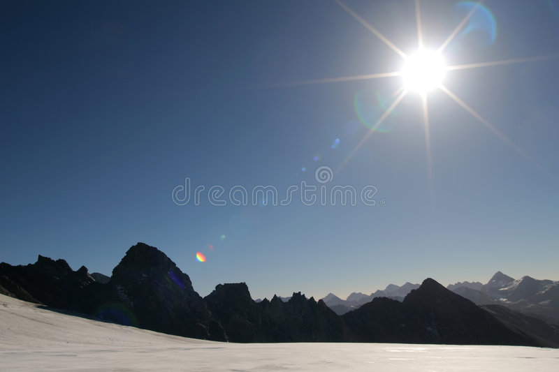 Sun In The Mountains Stock Photography