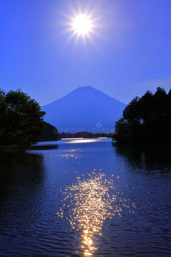 The sun and Mt. Fuji from Lake Tanuki Japan. 05/22/2018 royalty free stock photography