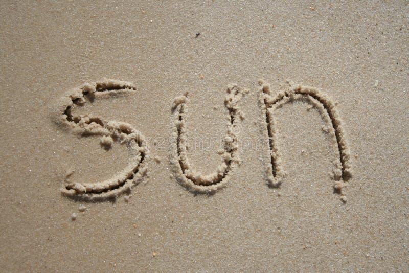 Sun na areia fotos de stock