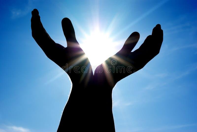 Sun nas mãos fotografia de stock royalty free