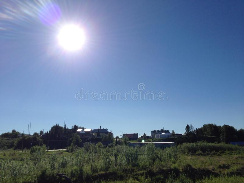 The sun is in the Northern village royalty free stock images