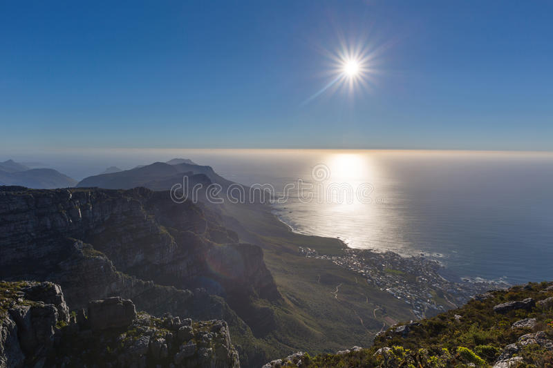 The sun over the Atlantic from Table Mountain. South Africa stock image