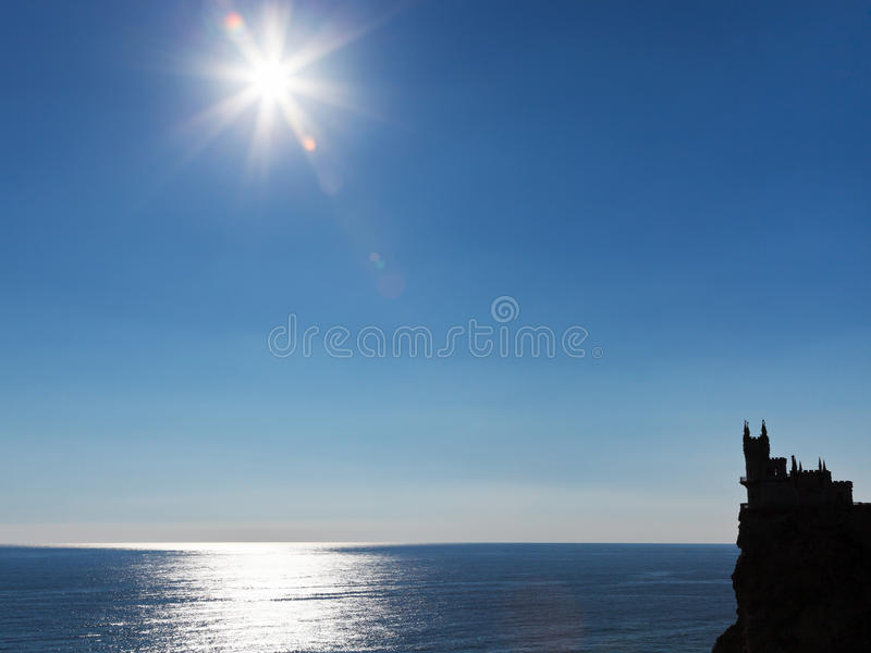 Sun over Black Sea and Swallow Nest castle stock image
