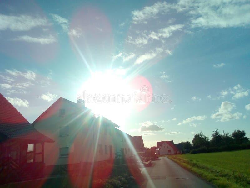 Sun over a house stock photography