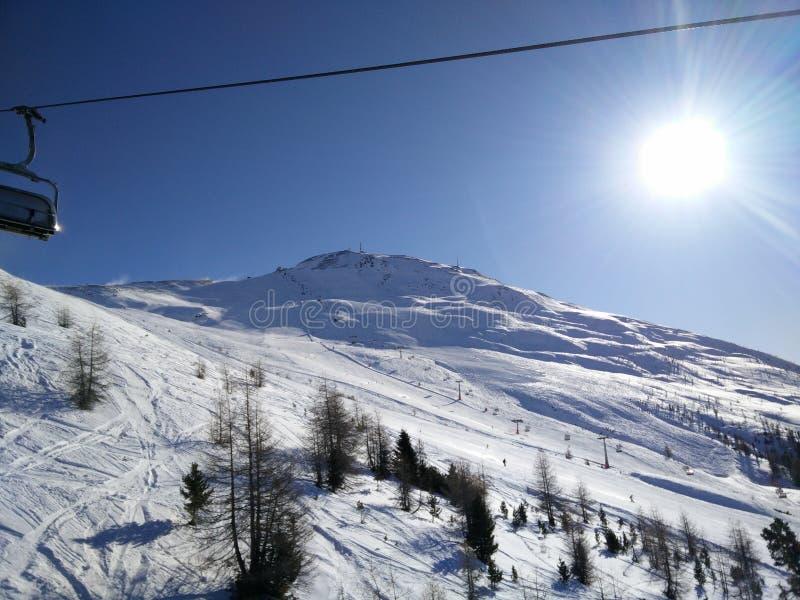 Sun over Livigno slopes royalty free stock image