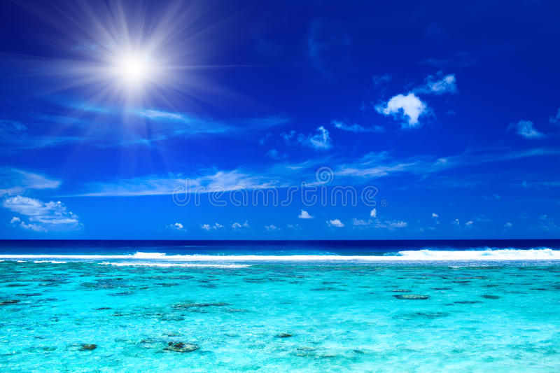 Sun over tropical ocean with vibrant colors. Sun and sky over tropical ocean with vibrant colors royalty free stock images