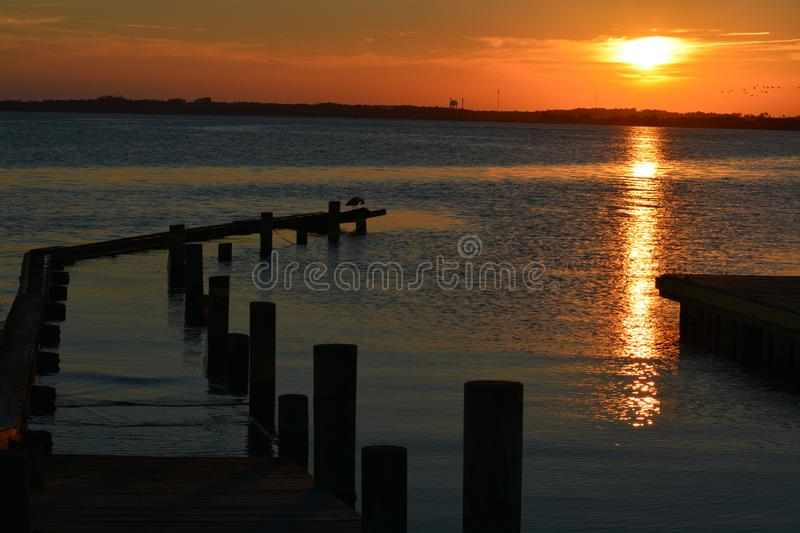 Sun over water stock image
