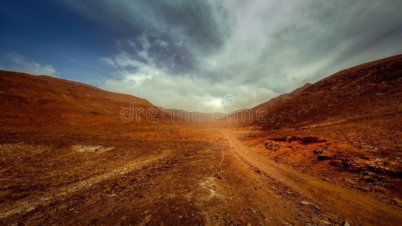 Sun peaking out in a valle inFuerteventura royalty free stock image