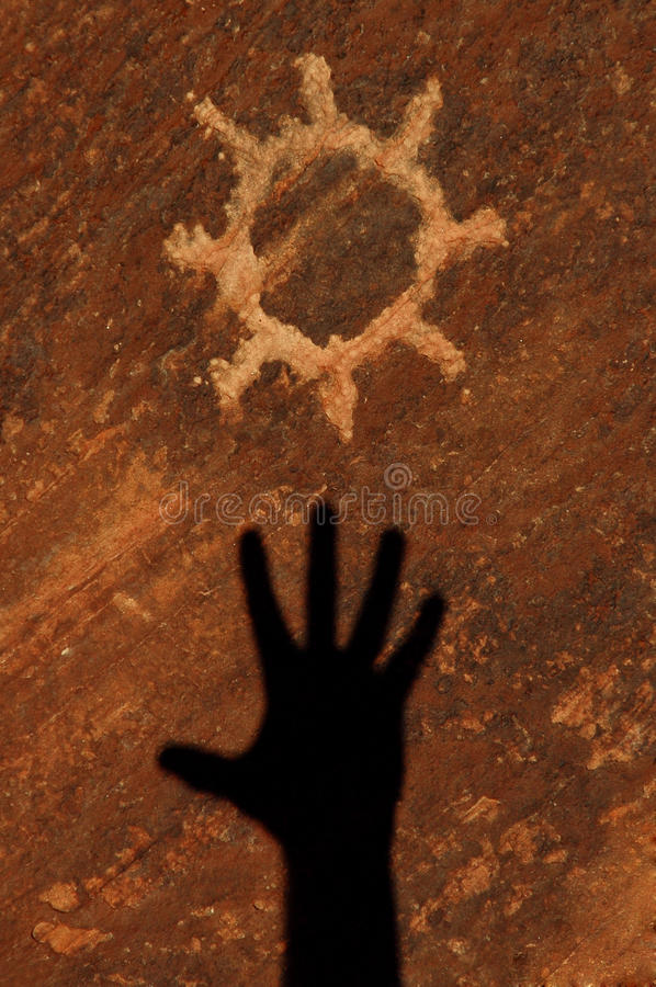 Sun Petroglyph Carved into Sandstone royalty free stock images