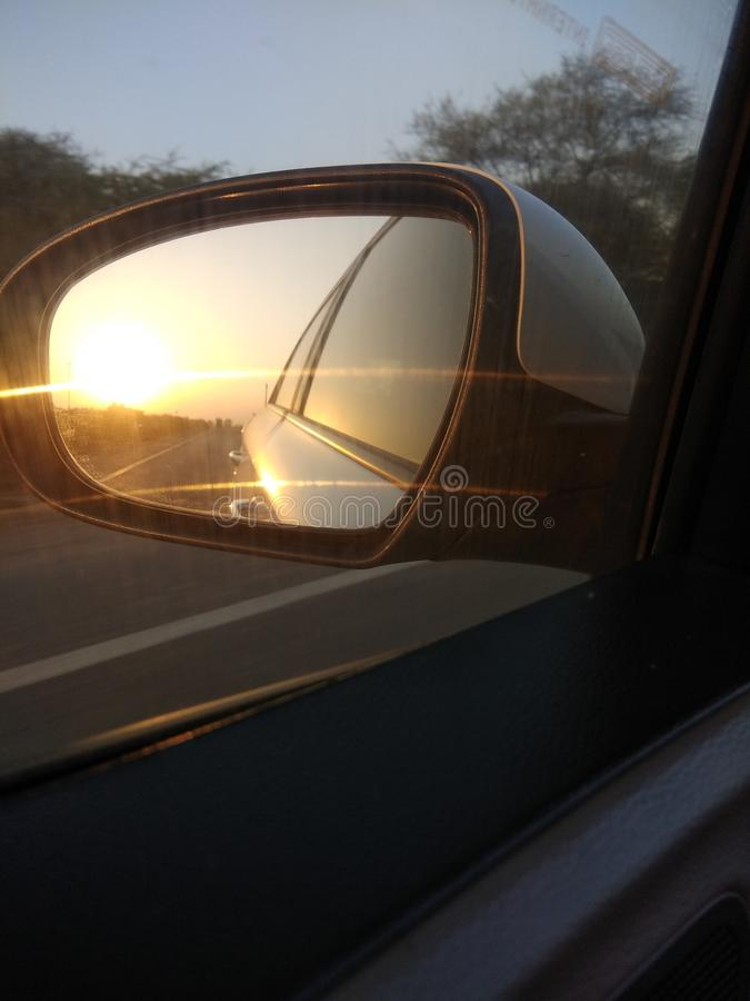 Sun from glass of car. Sun photography car driving click upload love it stock image