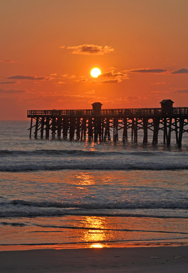 The Sun, the Pier and the Sea royalty free stock photography