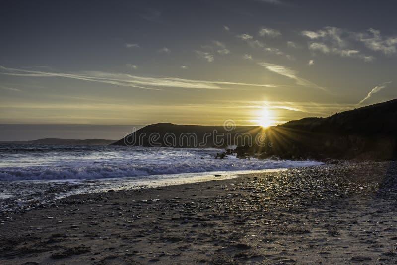 Sun pillar Uk. Weather uk.Vertical sun pillar visible during sunset over scenic beach on Pembrokeshire coast near Tenby, South Wales,Uk.Rare meteorological royalty free stock photography
