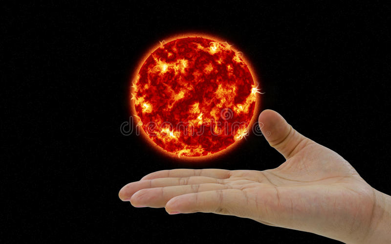 The Sun Planet Hovering Over The Hand Stock Photo