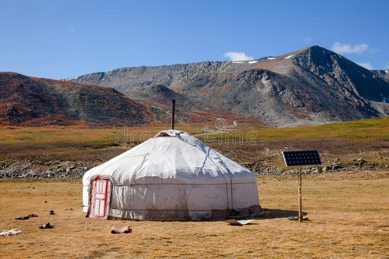 Sun powered traditional Mongolian ger in Altai Mountains Mongolia. Traditional Mongolian portable round tent ger covered with white outer cover powered by solar stock photography