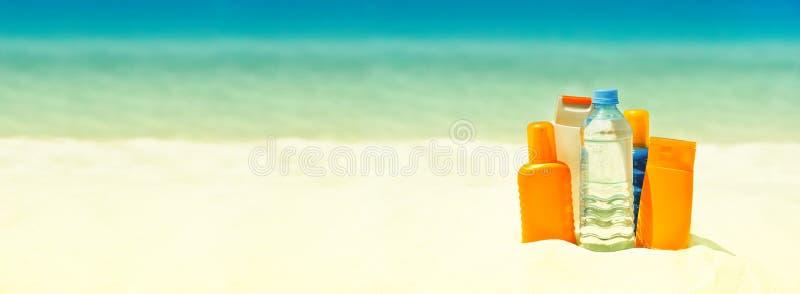Sun protection cream on the beach. Summer holidays stock image