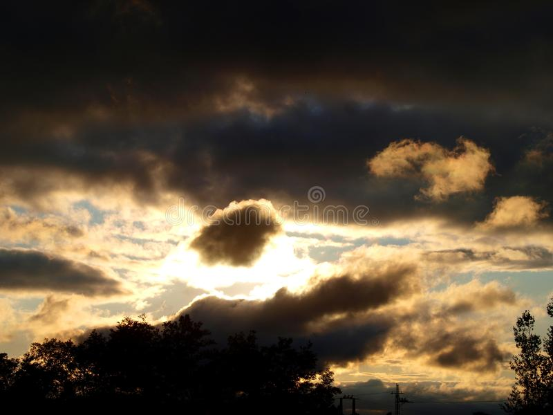 Sun between the rain clouds. stock images