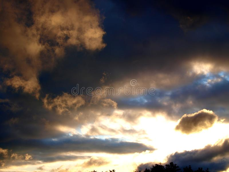 Sun between the rain clouds. royalty free stock image