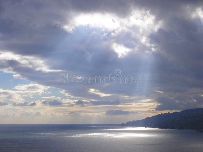 Sun ray after hurricane stock photos